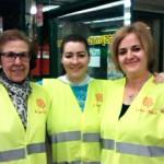 Tres de las voluntarias de la campaña de recogida de alimentos de Cáritas Interparroquial