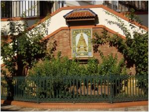 """La Carrera o Glorieta Virgen de Zocueca (incorrecta y erróneamente llamada recientemente por nuestros jóvenes como """"Plaza de Los Naranjos"""", desconociendo estos que así era conocido El Paseo)."""